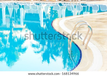 bending edge of the pool and stairs - stock photo