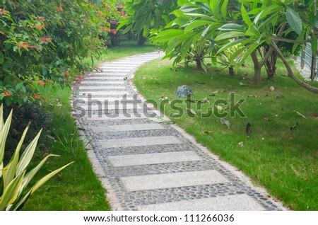 Bending garden stone path - stock photo