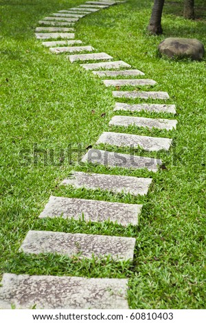 Bending garden stone path - stock photo