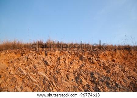 Beneath the asphalt and Layer of soil beneath the asphalt road - stock photo