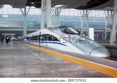 Bengbu, China - January 11,2011: modern train on the platform waiting for. China invests in fast and modern railway, trains with speed over 340 km/h.