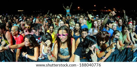 BENICASIM, SPAIN - JULY 19: People (fans) at FIB (Festival Internacional de Benicassim) 2013 Festival on July 19, 2013 in Benicasim, Spain. - stock photo