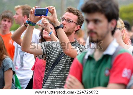 BENICASSIM, SPAIN - JULY 18: A man from the audience with his smartphone in a concert at FIB Festival on July 18, 2014 in Benicassim, Spain. - stock photo