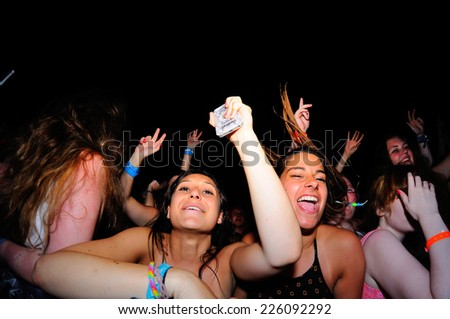 BENICASSIM, SPAIN - JULY 19: Crowd in a concert at FIB Festival on July 19, 2014 in Benicassim, Spain.