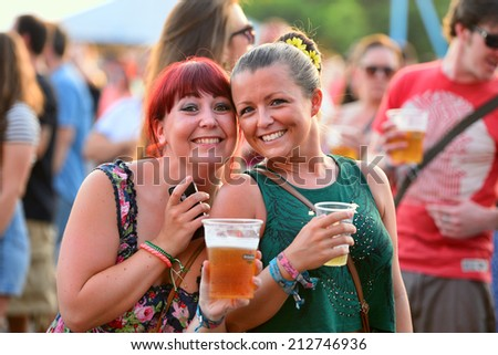 BENICASSIM, SPAIN - JULY 17: People have fun drinking beer and watching concerts at FIB Festival on July 17, 2014 in Benicassim, Spain. - stock photo