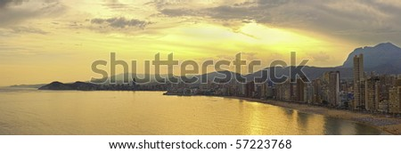 Benidorm bay at Costa Blanca sunset panorama. View from the end of the bay. - stock photo