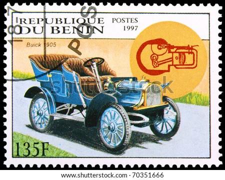 BENIN - CIRCA 1997: A stamp printed in Benin showing vintage car, circa 1997 - stock photo