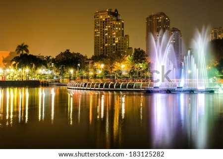 Benjakiti Park at Night in Bangkok, Thailand - stock photo