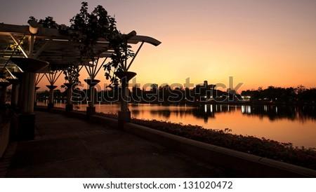 Benjakitti park at twilight in Bangkok, Thailand - stock photo