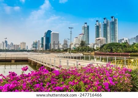 Benjakitti park Bangkok downtown city in evening, Thailand - stock photo