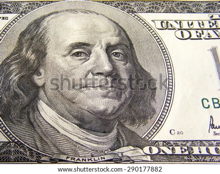 Benjamin Franklin depicted on one hundred dollar bill. Macro shot