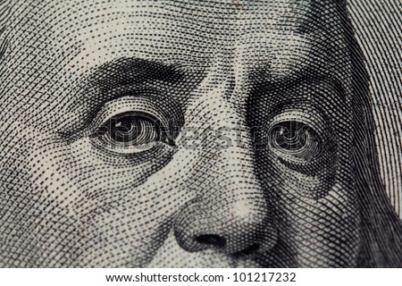 Benjamin Franklin face on a hundred dollars - stock photo