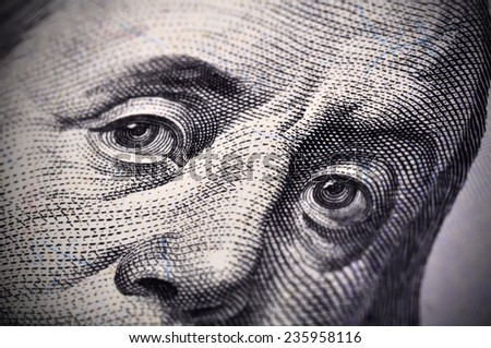 Benjamin Franklin face on the US $100 dollar bill. Extra close up - stock photo