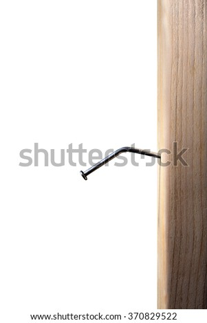 Bent Nail in Wood - stock photo