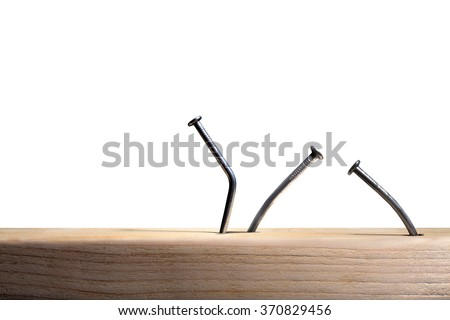 Bent nails in wood - stock photo