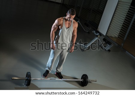 Bent Over Row Exercise For Back. Man Doing Heavy Weight Exercise For Back - stock photo