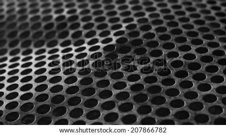 bent perforated metal background