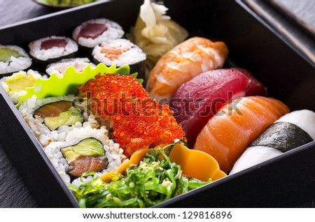 bento box with sushi - stock photo