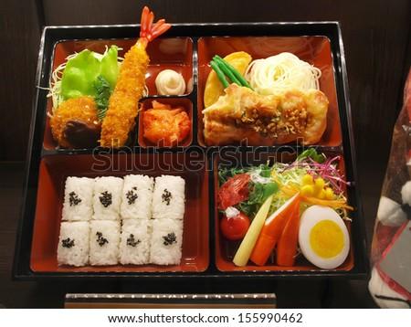 Bento Japanese food set prepared in box - stock photo