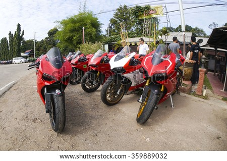 BENTONG, MALAYSIA -JANUARY 5 2015: Ducati 1199 Panigale parking on the side road. Photo at road Bt2 Jalan Bentong - Raub about 10 minute driving from Bentong Town, Malaysia.  - stock photo