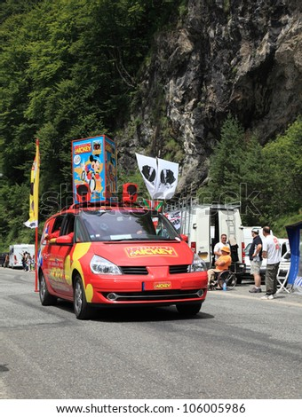 "BEOST,FRANCE-JUL 15:The car of the magazine ""Le Journal du Mickey"" during the passing of the publicity caravan on the mountain pass Aubisque in the 13 stage of the  ""Le Tour de France"" on July 15 2011 - stock photo"