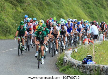 "BEOST,FRANCE-JUL 15:The peloton climbing the mountain pass Aubisque in the 13 stage of ""Le Tour de France"" on July 15 2011 in Beost France. - stock photo"