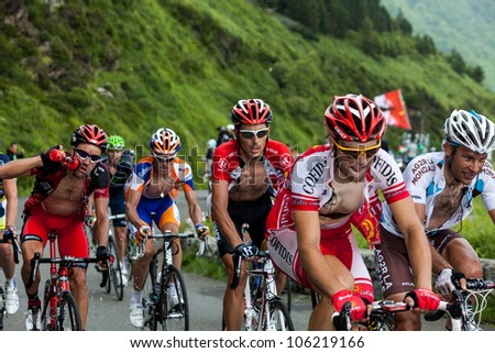 "BEOST,FRANCE-JUL 15:The peloton climbing the mountain pass Aubisque in the 13 stage of ""Le Tour de France"" on July 15 2011 in Beost France."