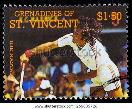 BEQUIA - CIRCA 1988: A stamp printed in Grenadines of St. Vincent shows Tennis Players Elie Nastase , circa 1988 - stock photo