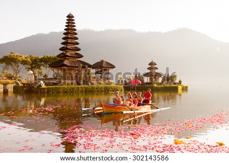 Beratan Lake in Bali Indonesia, June 16 2015 : Balinese villagers participating in traditional religious Hindu procession in Ulun Danu temple Beratan Lake in Bali Indonesia, June 16 2015 - stock photo