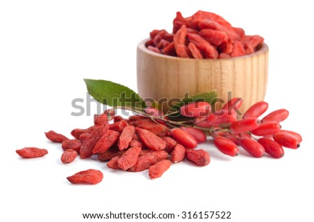 berberries near goji berries heap and bowl with goji isolated on white background - stock photo