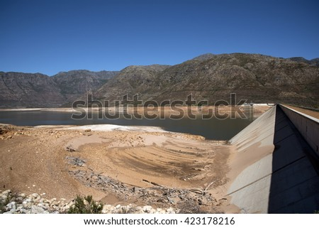 BERG RIVER DAM FRANSCHHOEK WESTERN CAPE SOUTH AFRICA - APRIL 2016 - The dam wall and low water level of the Berg River Dam Reservoir near Franschhoek in the Western Cape Southern Africa