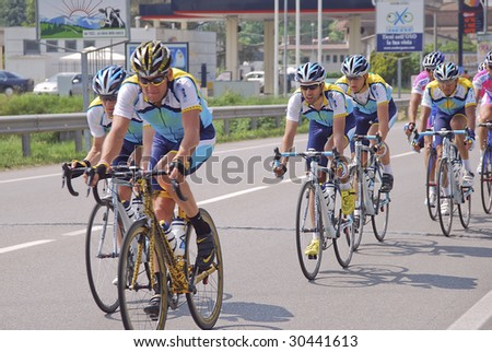 BERGAMO, ITALY - MAY 16: Lance Armstrong leads the pack in the Giro d'Italia 2009, The Centenary, 8° stage from Morbegno to Bergamo May 16, 2009 in Bergamo. - stock photo