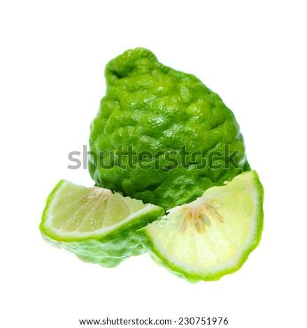 Bergamot and kaffir lime leaves on white background.  - stock photo