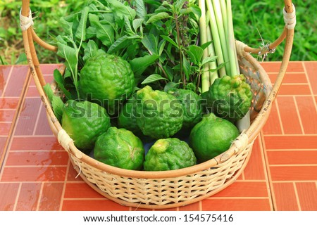 Bergamot and Lemon grass and Basil in basket is ingredient for Tom yum,Thai food - stock photo