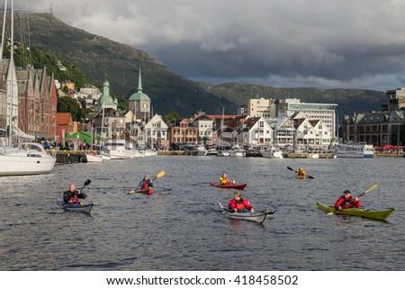 BERGEN, NORWAY - 21, AUGUST: A group of kayakers in the Harbor of Bergen on 21 august 2014