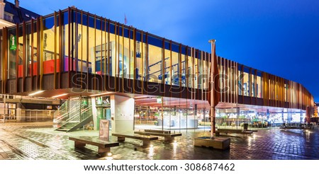 BERGEN, NORWAY - JULY 11: Bergen information center and harbor at night in the historic Bryggen district on July 11 in Bergen, Norway.