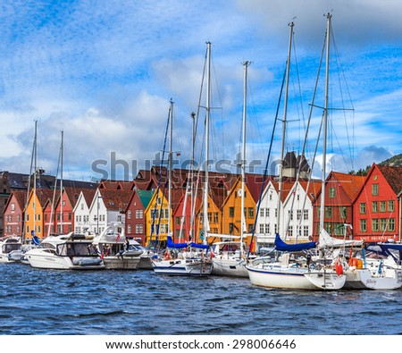 BERGEN, NORWAY - JULY 9: Boats at the Bryggen Hanseatic Wharf, a UNESCO World Heritage site with shops, hotels, and restaurants on July 9, 2015, in Bergen, Norway. - stock photo