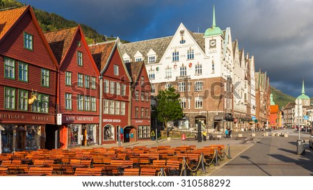 BERGEN, NORWAY - JULY 9: Panorama of the Bryggen Hanseatic Wharf, a UNESCO World Heritage site with shops, hotels, and restaurants on July 9, 2015, in Bergen, Norway. - stock photo