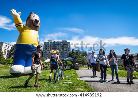 BERKELEY, CA- Apr 16, 2016: University of California Berkeley mascot Oski the Bear greets newly admitted students on Cal Day, who are invited to tour the campus and decide whether to attend. - stock photo
