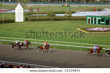 BERKELEY, CA - MARCH 28: Horse Race in action as horses rapidly run towards the finish line.   March 28th 2010 at Golden Gate Fields, California - stock photo