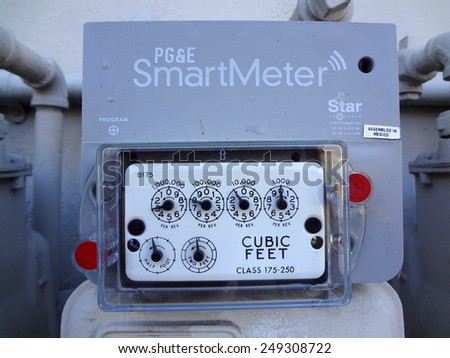 BERKELEY, CA - MAY 28: PG&E (utility co) electricity SmartMeters on residential buildings, Meters monitor energy quality and provide real time energy consumption data. MAY 28, 2011. - stock photo