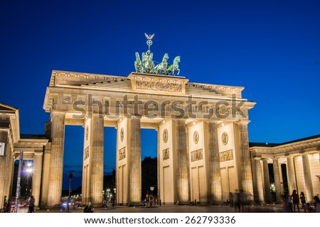 Berlin - AUGUST 4, 2013: Brandenburg Gate on August 4 in Germany, Berlin. Brandenburg Gate is a popular tourist attraction in Berlin - stock photo