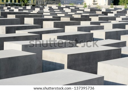 BERLIN - AUGUST 19: Close up detail of the concrete blocks that make up the public Memorial to the Murdered Jews of Europe on August 19, 2010 in Berlin. The Memorial also known as Holocaust Memorial. - stock photo