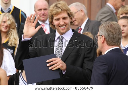 BERLIN - AUGUST 28: Dirk Nowitzki and the german President Chrsitian Wulff after the 'Silbernes Lorbeerblatt' ceremony at the presidential Bellevue palace on August 28, 2011 in Berlin, Germany.