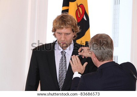 BERLIN - AUGUST 28: Dirk Nowitzki and the german President Chrsitian Wulff at the 'Silbernes Lorbeerblatt' ceremony at the presidential Bellevue palace on August 28, 2011 in Berlin, Germany. - stock photo