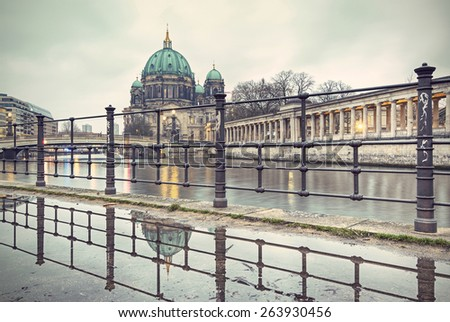 Berlin Cathedral (Berliner Dom) and Museum Island (Museumsinsel) reflected in puddle, Berlin, Germany, Europe, vintage style - stock photo