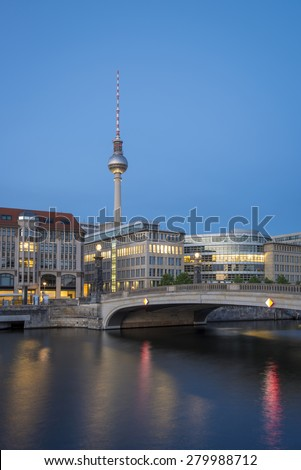 Berlin Cityscape, TV Tower and bridge (Friedrichsbruecke) over river Spree at evening, Berlin Mitte, Germany, Europe - stock photo