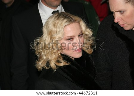BERLIN - FEBRUARY 13: Madonna greets fans prior to the 'Filth and Wisdom' Premiere as part of the 58th Berlinale Film Festival at the Zoo Palace on February 13, 2008 in Berlin, Germany - stock photo