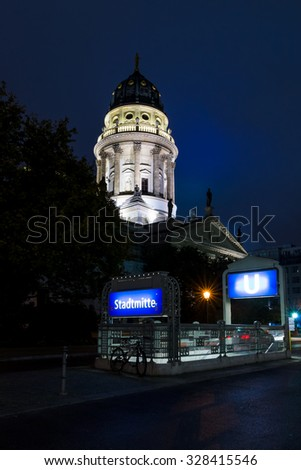 Berlin. German Cathedral on Gendarmenmarkt and the entrance to the underground station Stadtmitte - stock photo