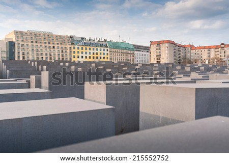 BERLIN, GERMANY - APR 17: The Holocaost monument in Berlin on April 17, 2013 .Consist of 2711 concrete blocks whit different highs and parallel alignment placed on 19.000 squaremeters urban area. - stock photo